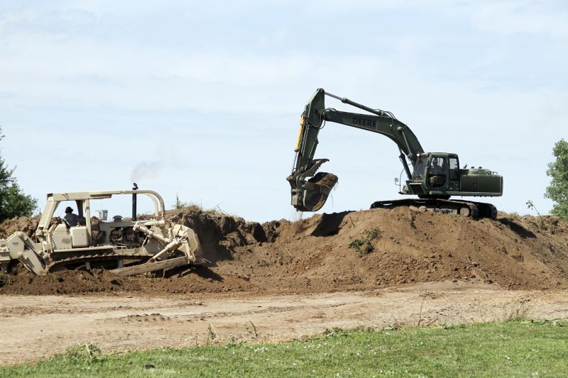 Engineers of the 891st Engineer Company use a backhoe and bullsdozer during annual training