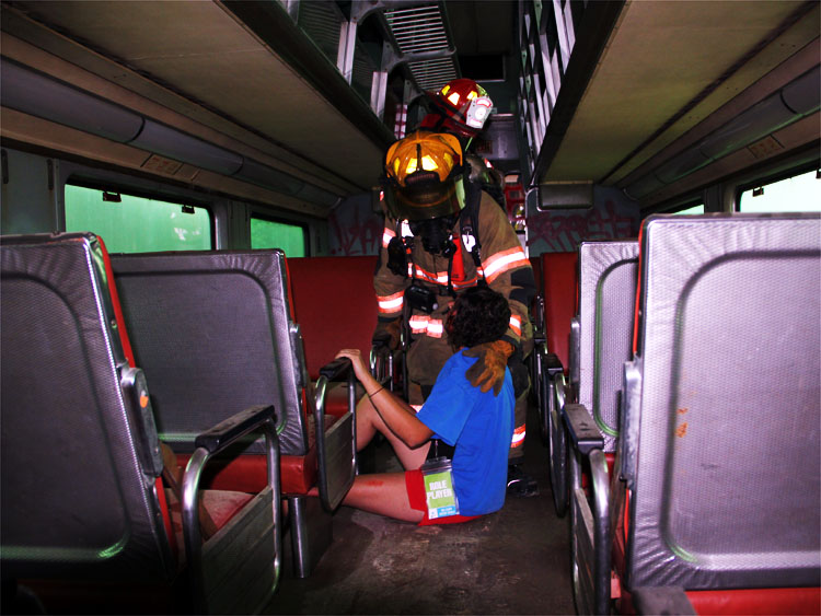 Railcar interior with firefighter and victim